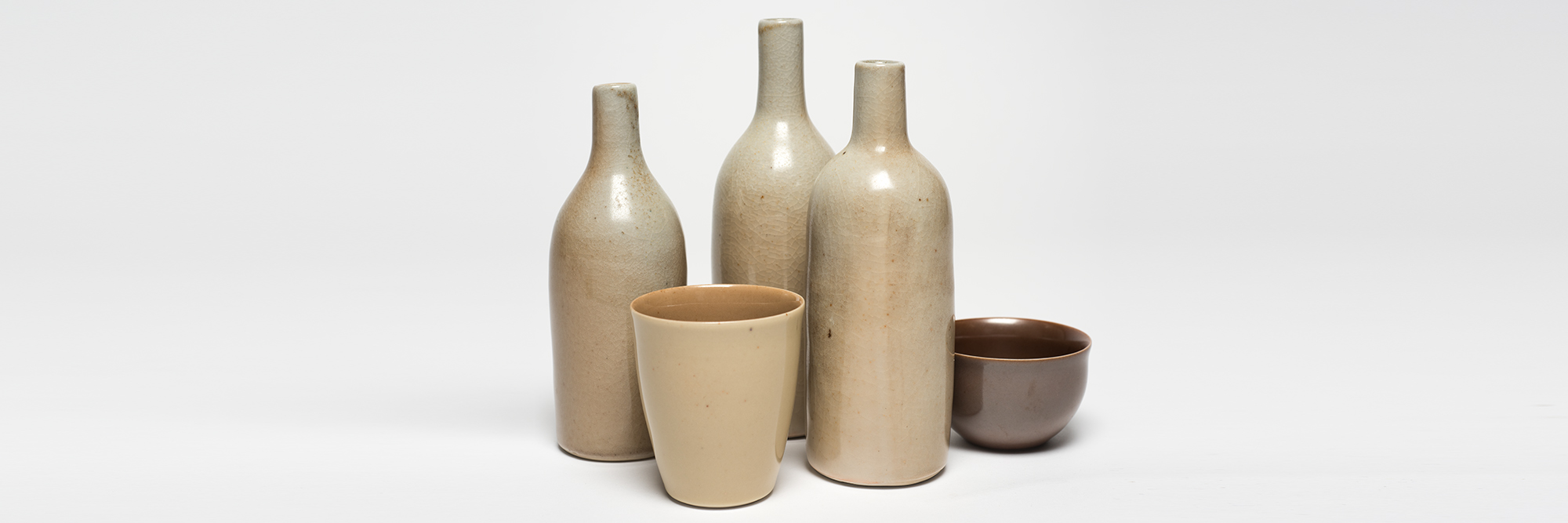 Gwyn Hanssen Pigott, Still Life – three bottles, bowl and beaker, 1992, glazed porcelain. Collection Bendigo Art Gallery. Image reproduction courtesy of the estate of Gwyn Hanssen Pigott and Sophie Gannon Gallery. Photo: Ian Hill