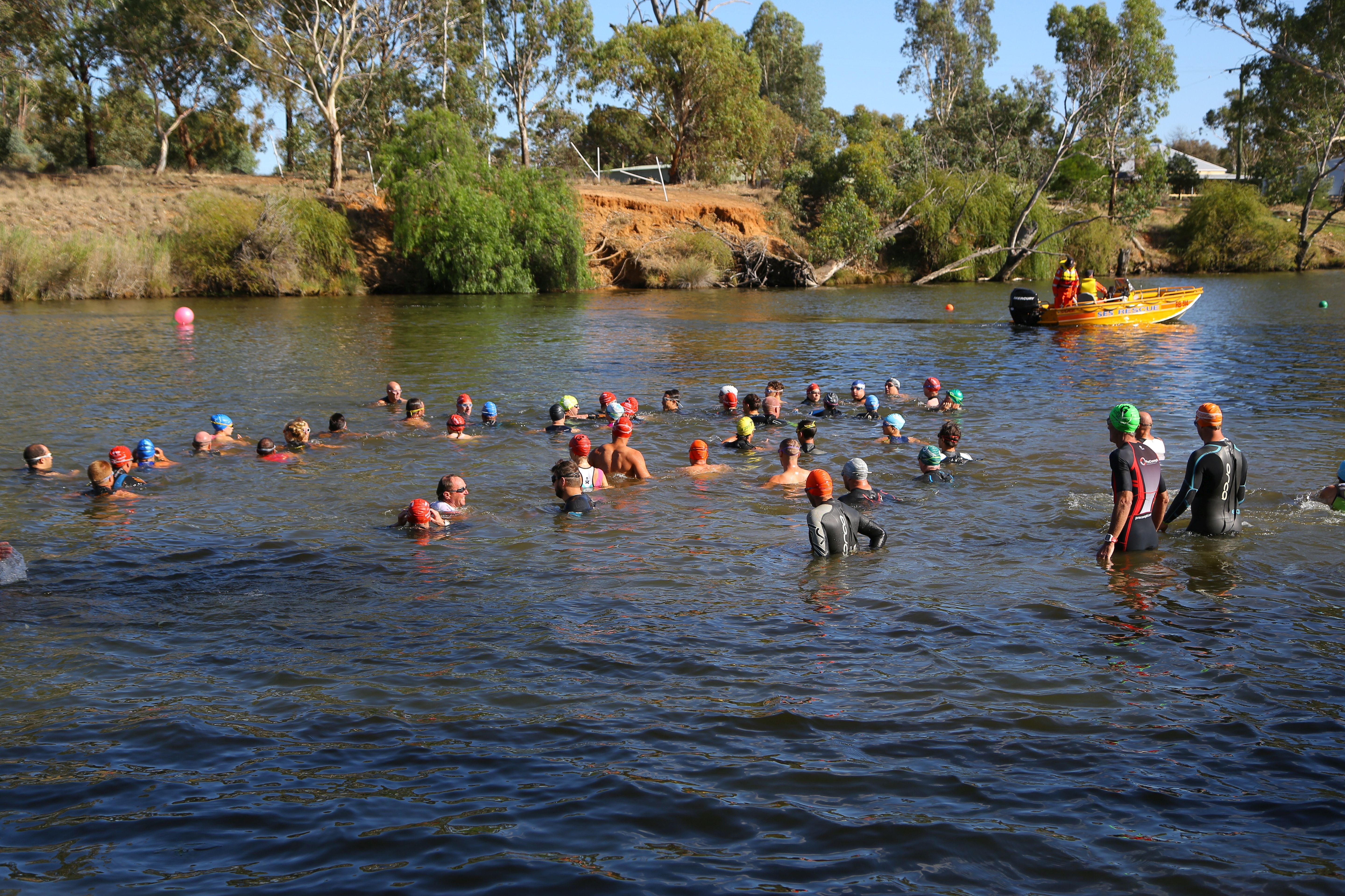 Loddon River - Swimmers listen carefully to instructions from the coach; this will help their performance in the race.