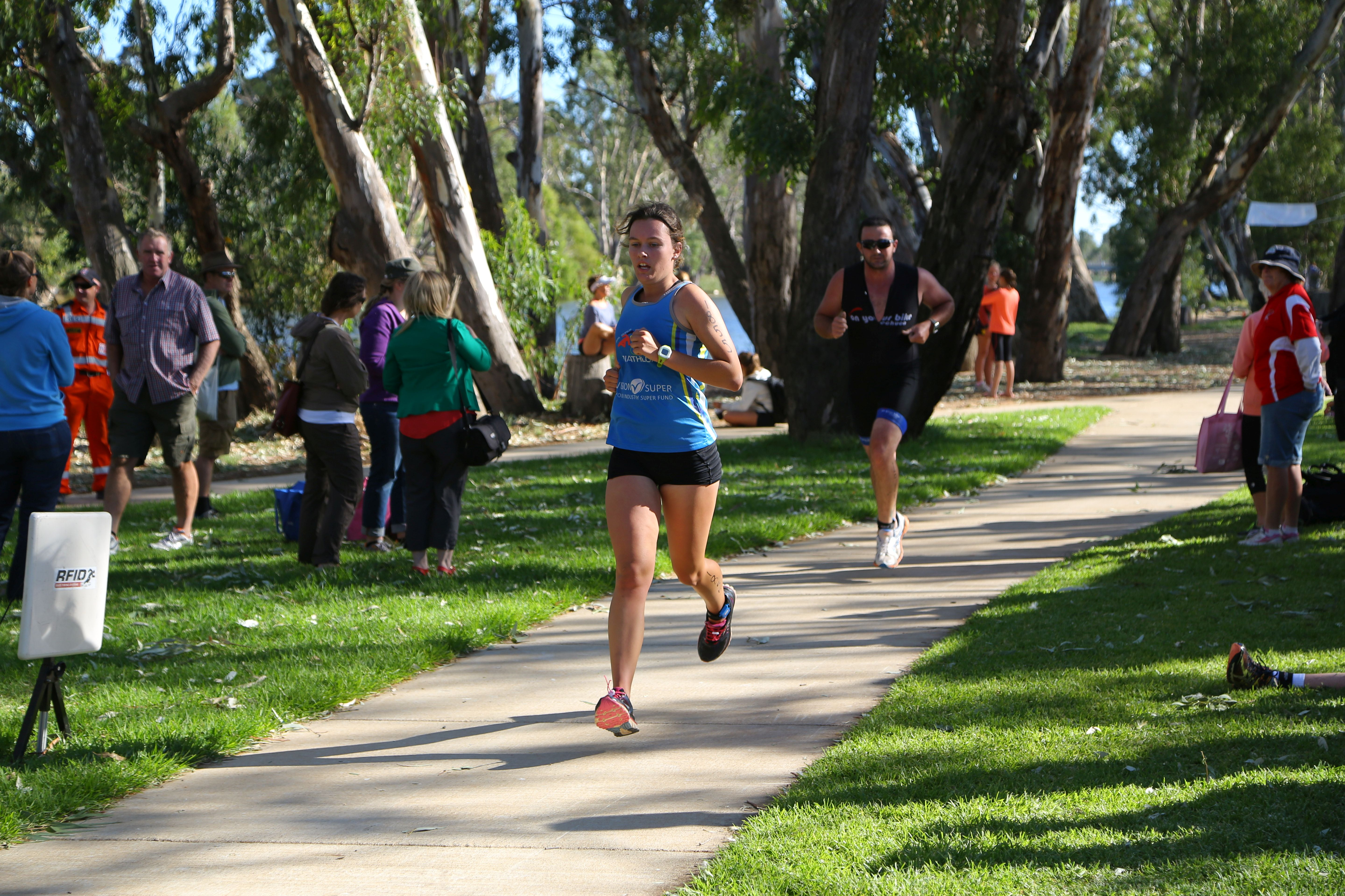 Bridgewater Triathlon. Competitors competing in the running event along the path beside the Loddon River.