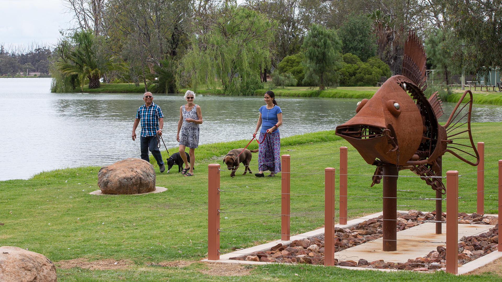 People walking dogs on the Lake Boort Sculpture Trail