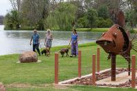 Family walking past fish sculpture near Little Lake Boort