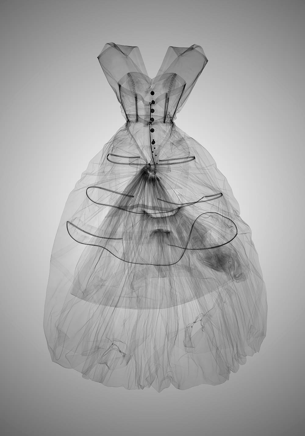 X-ray showing the boning and hooped skirt. X-ray photography by Nick Veasey, 2016 © Nick Veasey.