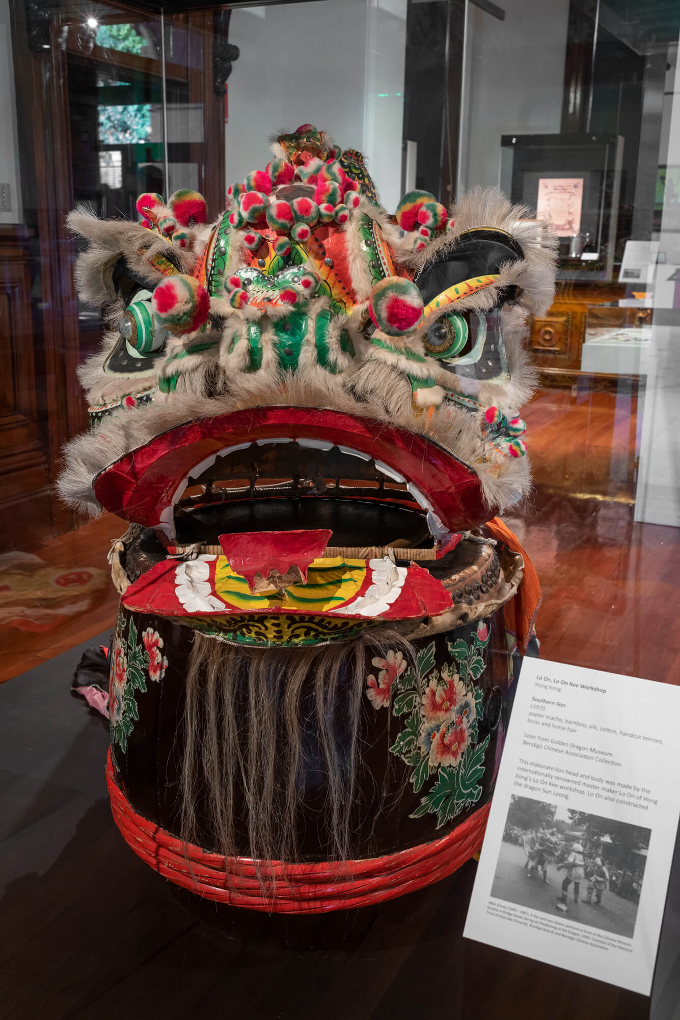 Lo On, Lo On Kee Workshop, Hong Kong, Southern lion, c1970, papier mache, bamboo, silk, cotton, handcut mirrors, brass and horse hair. Hand painted drum, c1950, wood, paint, skin, cane, metal. Loans from Golden Dragon Museum, Bendigo Chinese Association Collection. Photograph: Ian Hill