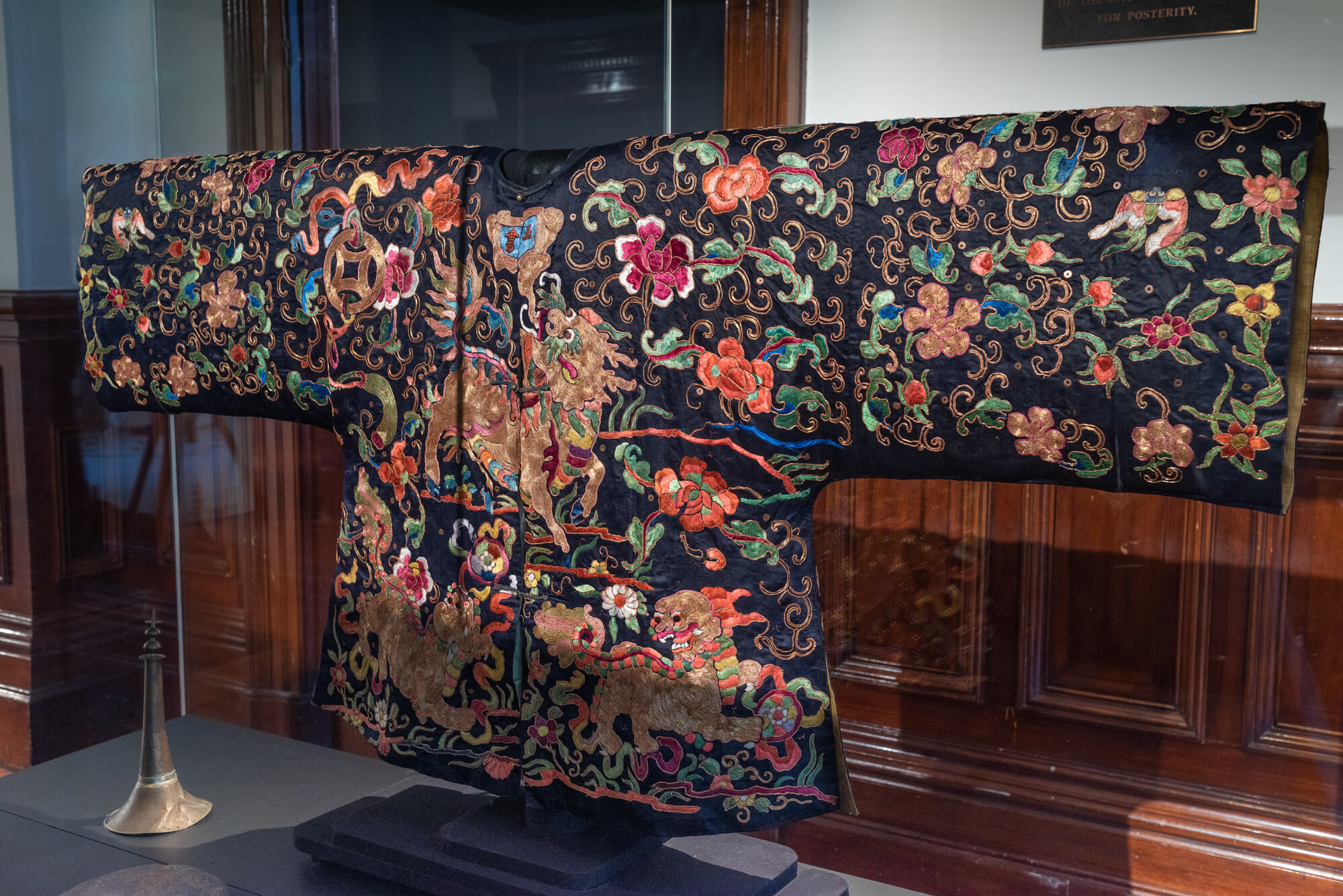 Parade jacket, c1880, silk, sequins, gold couching. Conserved by Betty Luke in 1989  Loan from Golden Dragon Museum, Bendigo Chinese Association Collection. Photograph: Ian Hill