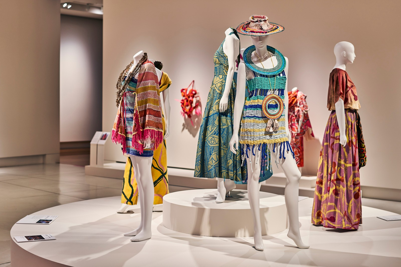 Installation shot of **Piinpi: Contemporary Indigenous Fashion**